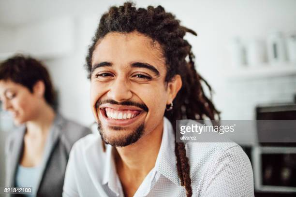 Cheerful young african man at startup