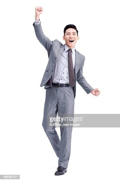 cheerful young businessman punching the air - hands up ストックフォトと画像