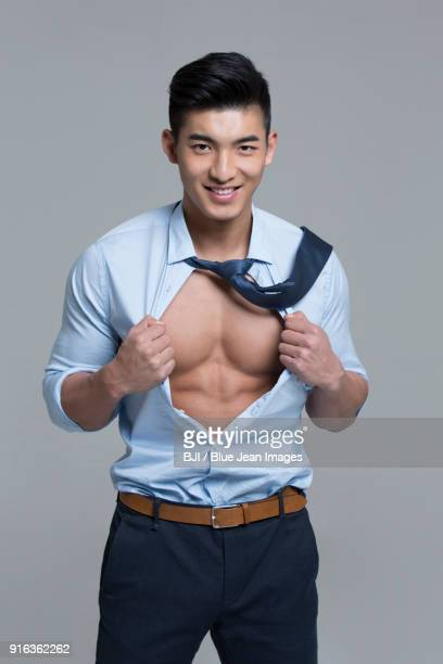 cheerful young businessman showing muscles - open collar stock pictures, royalty-free photos & images