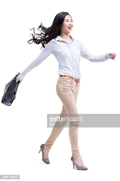 Cheerful young businesswoman on the move
