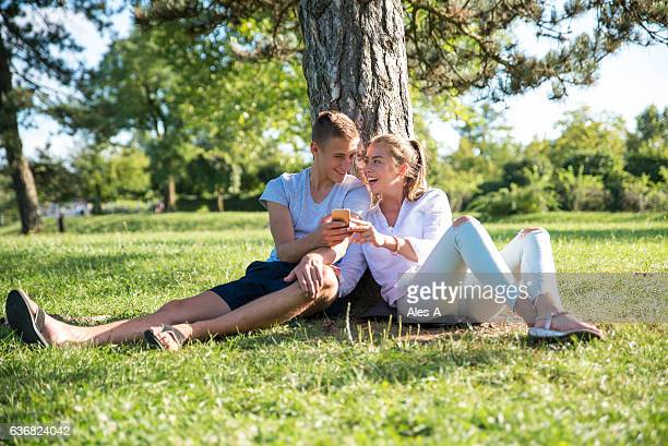 Cheerful young couple in the park