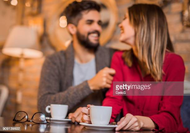 cheerful young couple loves to drink coffee together in the morning. - coffee drink stock pictures, royalty-free photos & images