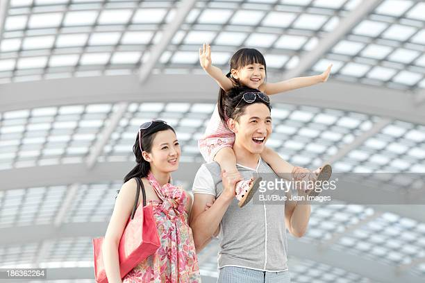 Cheerful young family at the airport