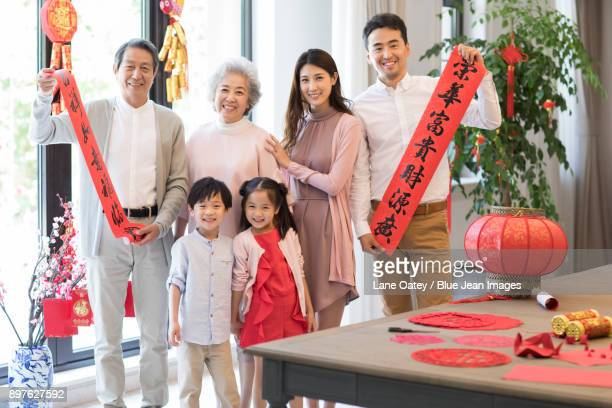 Cheerful young family celebrating Chinese New Year