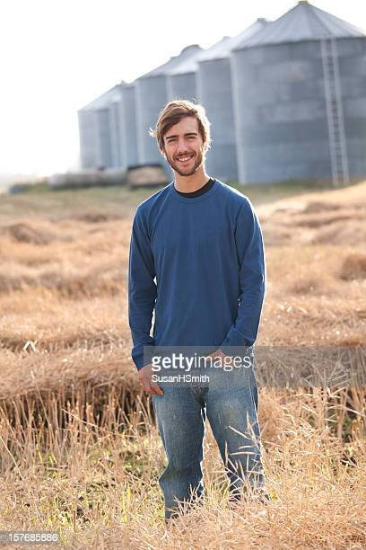 cheerful young farmer with grain bins - karl lagerfield bildbanksfoton och bilder