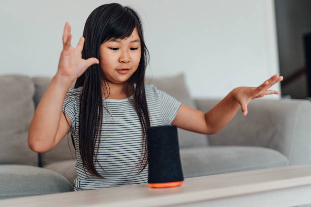 Cheerful Young Girl Using Smart Speaker At Home