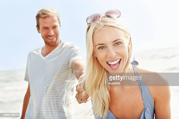 Cheerful young girl with boyfriend together having fun