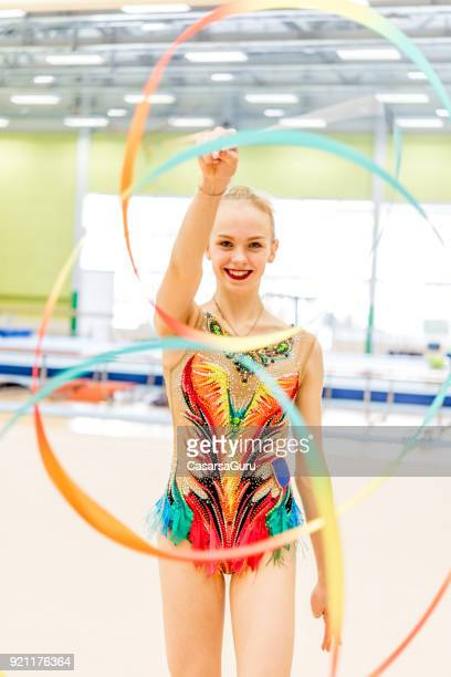 cheerful young gymnastics athlete practicing with ribbon - acrobatic activity stock pictures, royalty-free photos & images