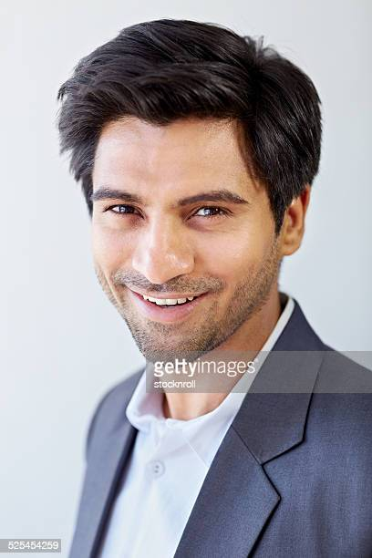 Cheerful young Indian businessman
