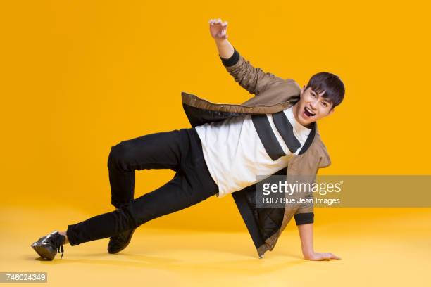 cheerful young man dancing - performer stock pictures, royalty-free photos & images