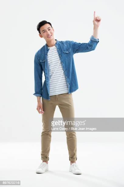 Cheerful young man pointing