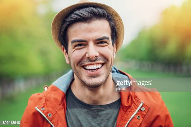 cheerful young man with a hat - toothy smile stock pictures, royalty-free photos & images