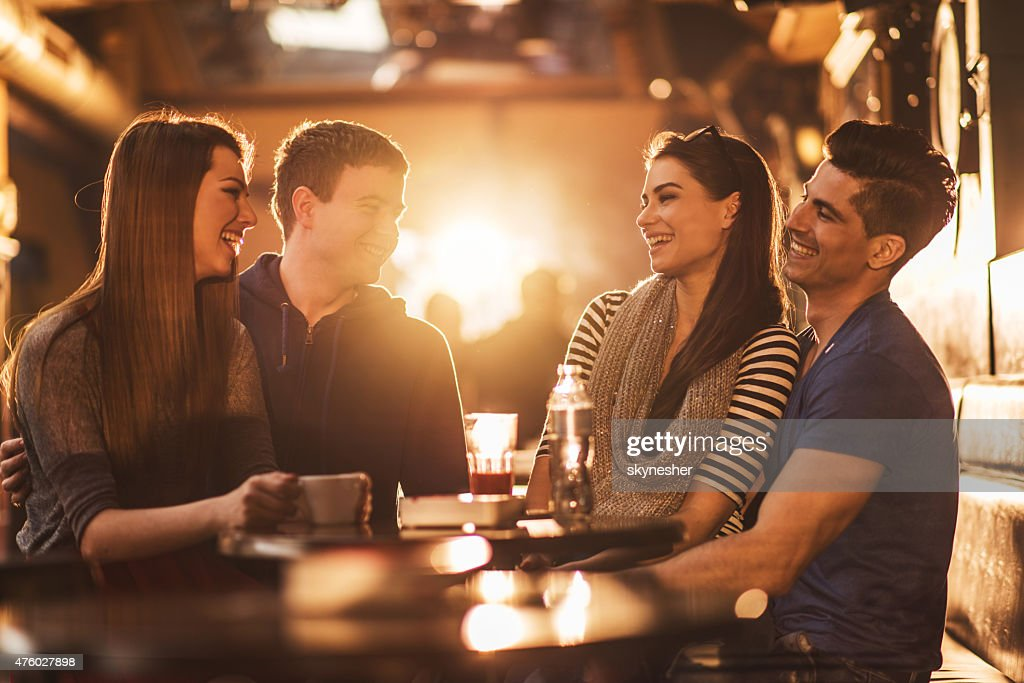 Cheerful Young People Communicating And Enjoying In A Cafe High Res Stock Photo Getty Images