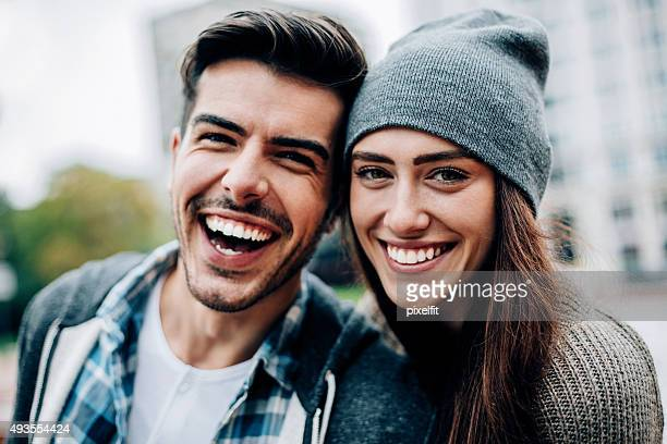 cheerful young people - boyfriend stock pictures, royalty-free photos & images