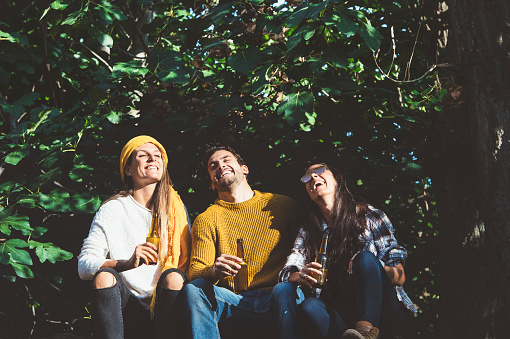 Cheerful young people relaxing on outdoor with beer. - gettyimageskorea