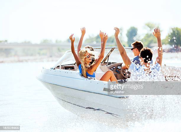 cheerful young people riding in a speedboat. - boat stock pictures, royalty-free photos & images