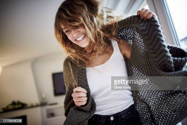 cheerful young woman at home - dancing stock pictures, royalty-free photos & images