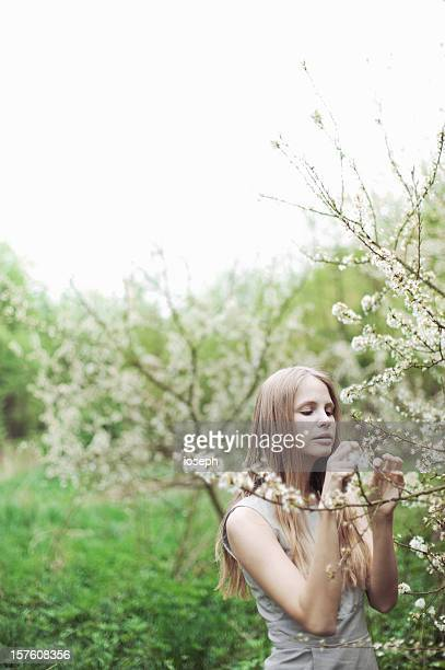 Cheerful young woman enjoying spring outside
