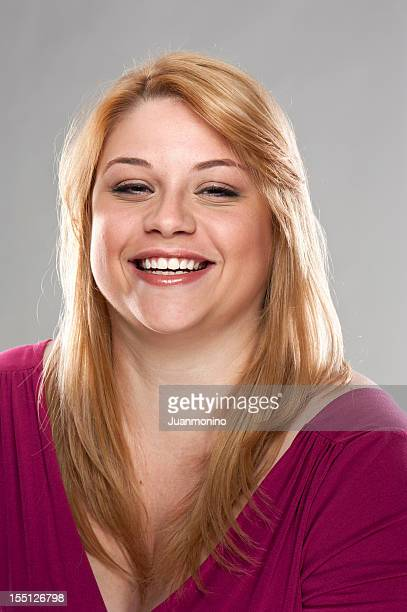 cheerful young woman (real people) - fat blonde women stock photos and pictures