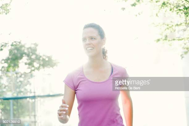 Cheerful Young Woman Running Outdoors In The Early Morning