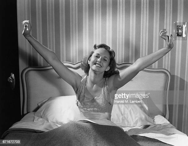 Cheerful Young Woman Waking Up