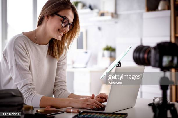 cheerful young woman working as vlogger doing a live stream on the internet - live streaming stock pictures, royalty-free photos & images