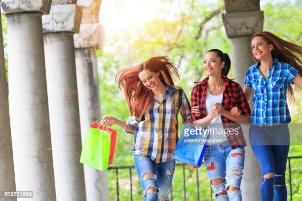 Cheerful young women enjoying the new purchases