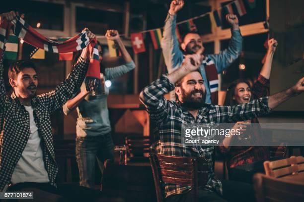 Cheering at the pub