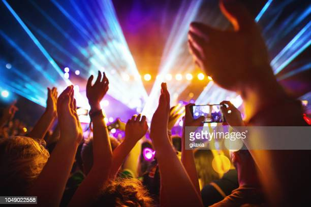 cheering crowd at a concert. - crowd of people stock pictures, royalty-free photos & images
