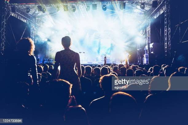 cheering crowd at rock concert - popular music concert stock pictures, royalty-free photos & images