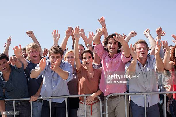 cheering crowd with arms raised - front row photos stock pictures, royalty-free photos & images