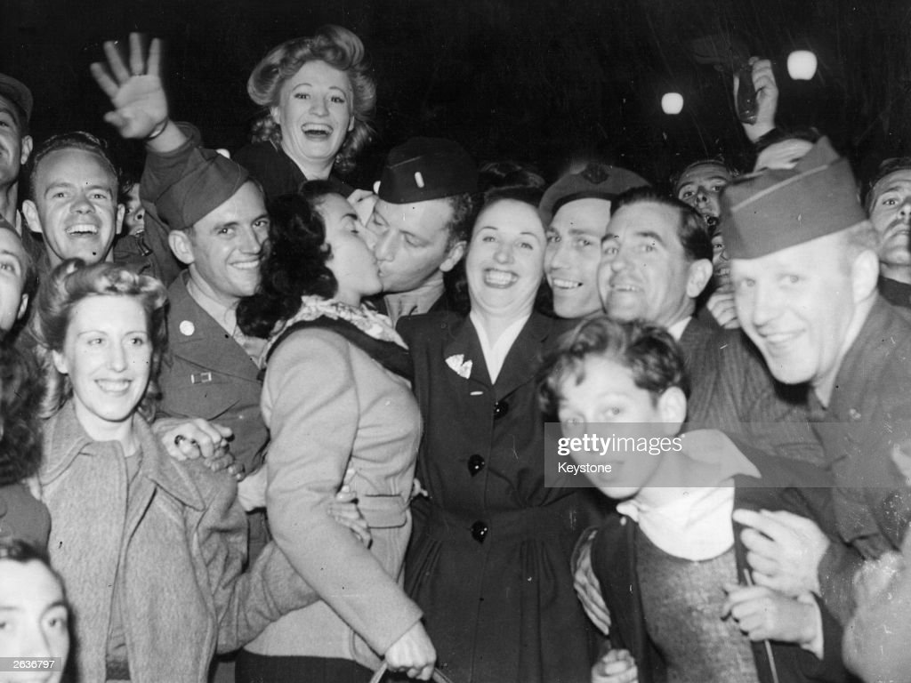 Cheering crowds in Piccadilly during the VJ Day celebrations.