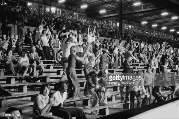 Cheering fans at Chelsea FC v Notts County FC match at Stamford Bridge, London, UK, 25th August 1976.