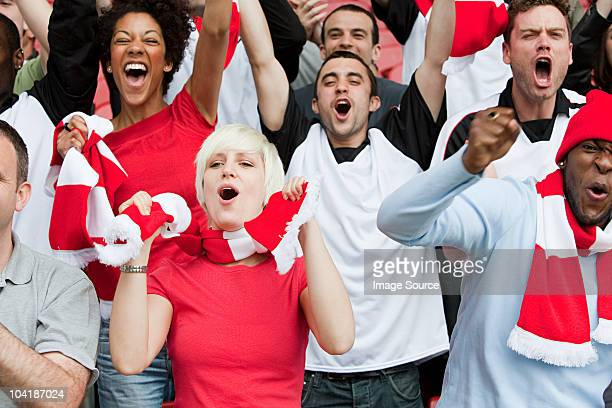 cheering fans at football match - england football stock pictures, royalty-free photos & images