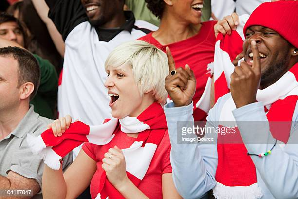 cheering fans at football match - chanting stock pictures, royalty-free photos & images