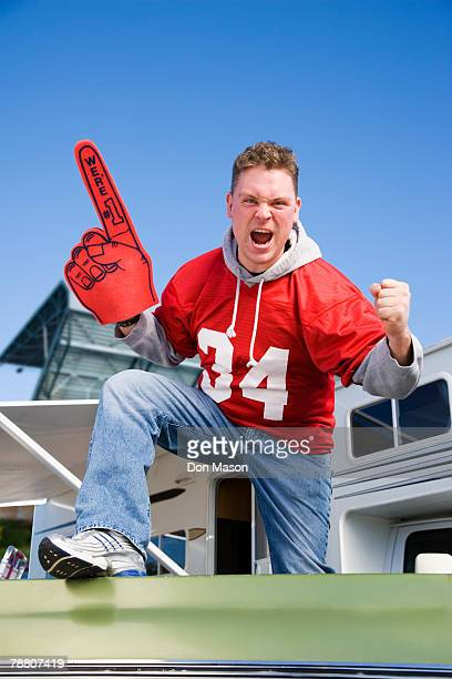 cheering football fan - foam finger stock photos and pictures