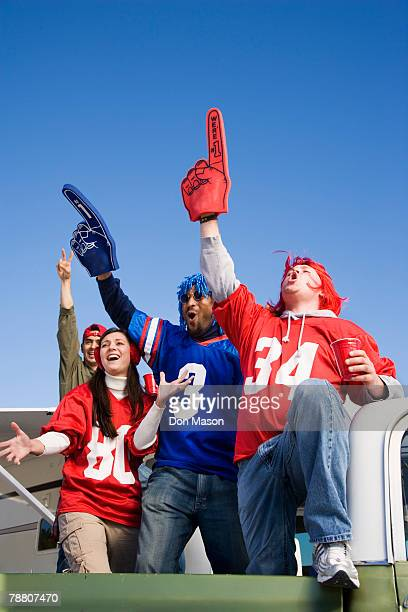 cheering football fans - foam finger stock photos and pictures