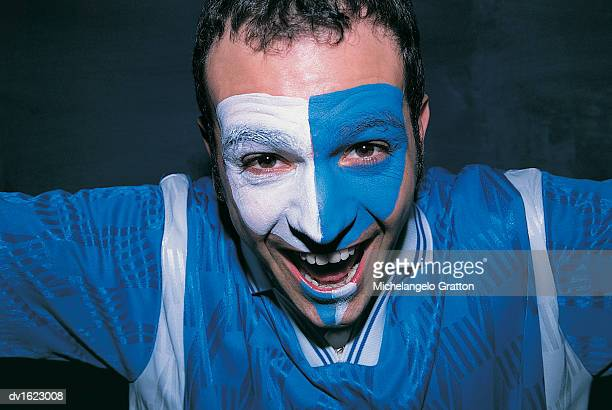 Cheering Football Supporter With a Painted Face