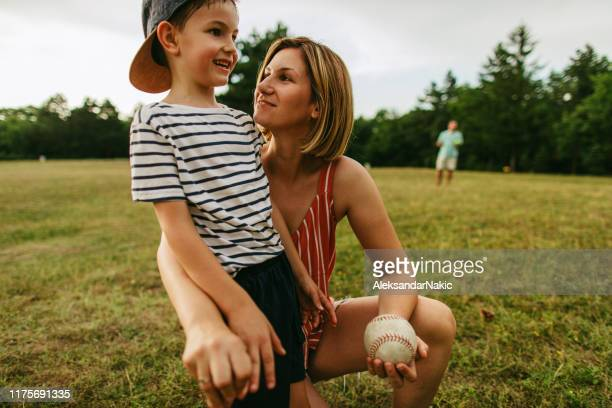 cheering for my little player - baseball mom stock pictures, royalty-free photos & images