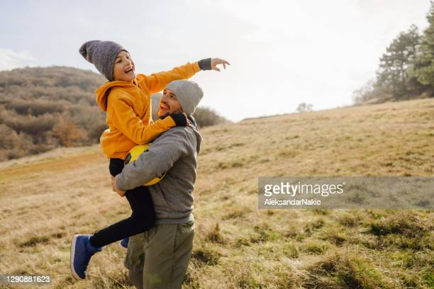 cheering for my son! - sporting term stock pictures, royalty-free photos & images