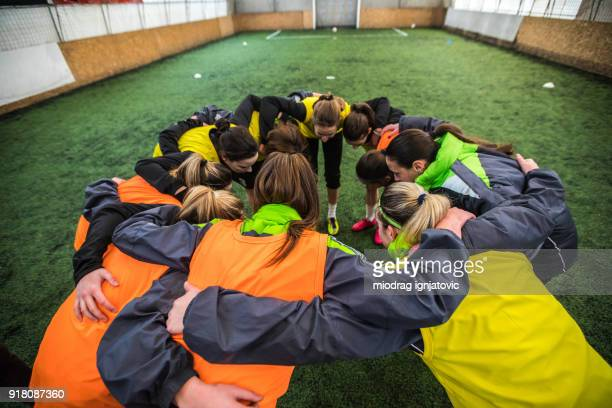 cheering for success - huddling stock pictures, royalty-free photos & images