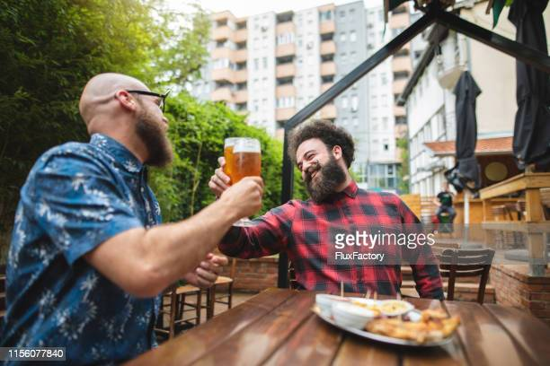 cheering for  the friendship that will last forever - best sunglasses for bald men stock pictures, royalty-free photos & images