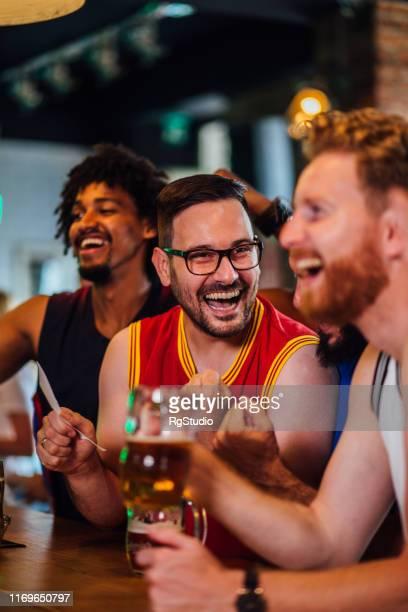 cheering for the winning match - campionato mondiale di sport foto e immagini stock