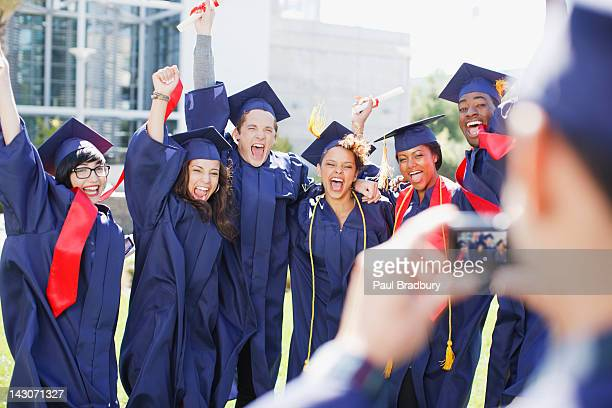 Cheering graduates taking picture of themselves