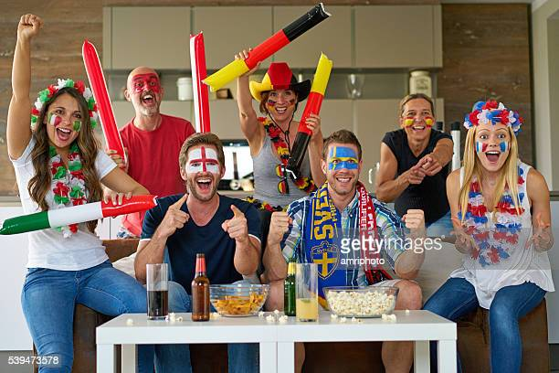 cheering international soccer fans - global village stock pictures, royalty-free photos & images