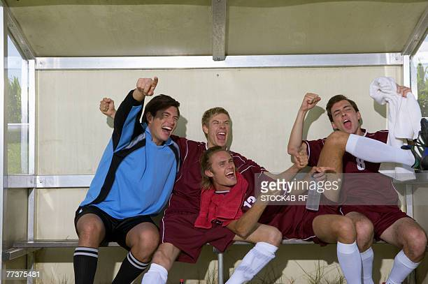 cheering kickers sitting on substitutes' bench - sideline stock pictures, royalty-free photos & images