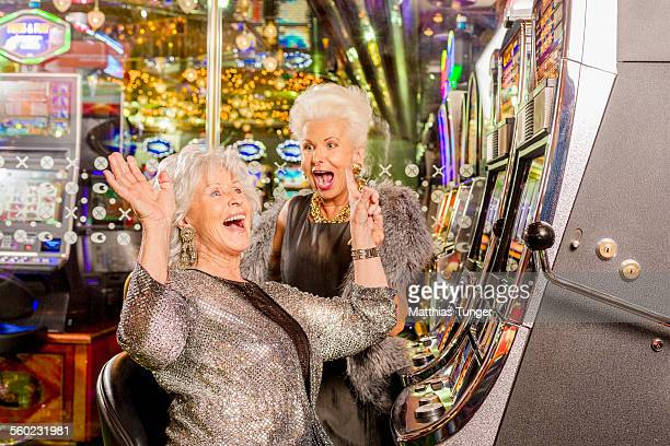 cheering ladies in a casino - silver dress stock pictures, royalty-free photos & images