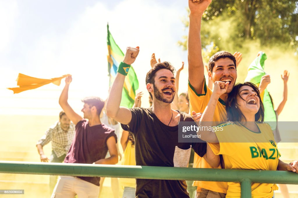Cheering multi-ethnic game supporters : Stock Photo