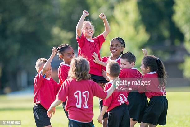 cheering on a teammate - soccer team stock pictures, royalty-free photos & images