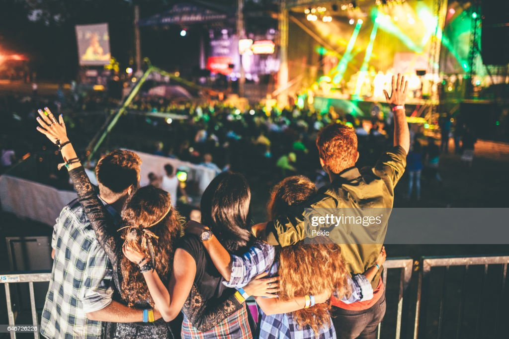 Cheering on their favourite band : Stock Photo